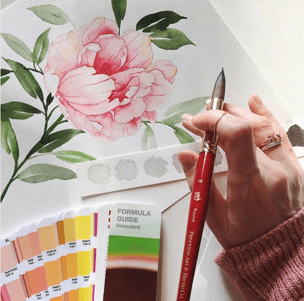 Jenna Rainey of Mon Voir painting watercolor with Princeton Artist Brush Co round watercolor brush brushes
